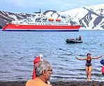 Excursion No. 12. into the old caldera of Deception Island.it's absolutely amazing what humans will do for fun.the Polar plunge, witnessed by an array of chicken photographers and a few bewildered (25989828996).jpg