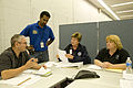 FEMA - 37492 - FEMA officials at a table during a FEMA teleconference.jpg
