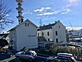 """Fengselet (""""The Prison"""") and restaurant in Jens Hystadvegen, Skrivarvegen in front, Radio tower (Telebygget), Borggata 10 in the backgrund. Leirvik, Stord, Norway 2018-03-13 b.jpg"""