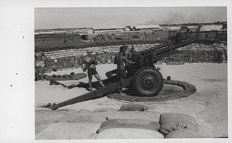 2nd Marine Division (South Korea) - 2nd Brigade gunners fire a 105mm from their base near Hoi An, 10 July 1968