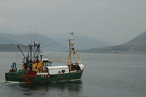 A trawler leaving the port of Ullapool, north-...