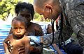 Flickr - The U.S. Army - Capt. Mark Poirier gives medical attention to a baby in Haiti.jpg