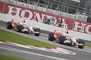 Giancarlo Fisichella leads Adrian Sutil at the 2008 Canadian Grand Prix.