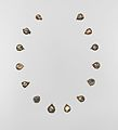 Fourteen pendants for a necklace MET DP-889-22.jpg