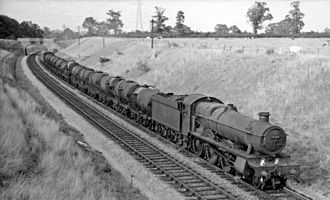 Great Western Railway wagons - Afternoon of 22 August 1959: GWR Hall Class 4-6-0 No. 4941 Llangedwyn Hall hauls an empty train of 13 Milk Tank Wagons and one Siphon G past Frome, Somerset on the Reading to Taunton line, on return run from the former Express Dairies depot in Kensington, London to Plymouth, Devon
