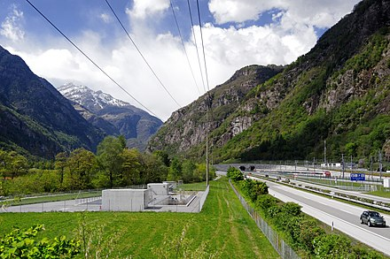 Leventina Valley. Leading to Central Switzerland, the Gotthard axis consists of several railways and highways, here the A2 motorway and south portal of the Gotthard Base Tunnel, the lowest route through the Alps