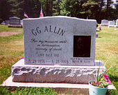 "A marble gravestone engraved ""GG Allin: For my mission ends in termination, vicinity of death. Live fast die; 8-29-1956 – 6-28-1993"""