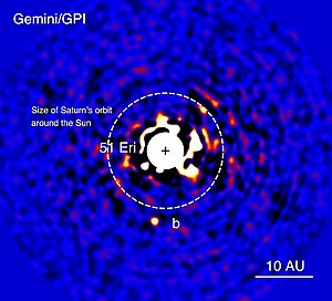 "Gemini Observatory - Gemini Planet Imager (GPI) image of a planet orbiting a distant star known as 51 Eridani. The bright central star has been mostly removed by a hardware and software mask to enable the detection of the exoplanet (labelled ""b"") that is one millionth as bright. Credits: J. Rameau (Univ. of Montreal) and C. Marois (NRC Herzberg, Canada)."