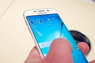 Samsung Galaxy S6 - The Galaxy S6 Edge is similar in concept to the Galaxy Note Edge, although the curvature of the screen is toned down in comparison.