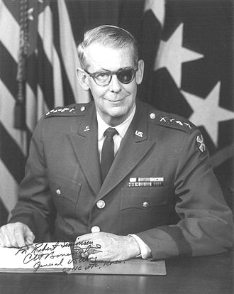 """Charles H. Bonesteel III - Bonesteel with his """"eyepatch"""", an opaque lens behind his eyeglasses which was required after surgery for a detached retina."""
