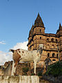 Goat with old temple in Orchha, Madhya Pradesh, India.jpg