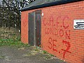 Graffiti, disused toilets, A40, Barnwood - geograph.org.uk - 1069991.jpg