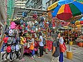 HK 灣仔 Wan Chai 太原街 Tai Yuen Street outdoor market sidewalk stall n visitors May-2014 hats n sun breach umbrella.JPG