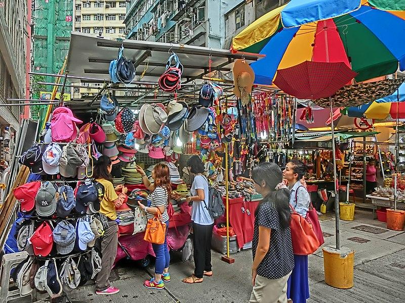 File:HK 灣仔 Wan Chai 太原街 Tai Yuen Street outdoor market sidewalk stall n visitors May-2014 hats n sun breach umbrella.JPG