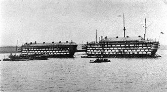 The Gallery of H.M.S. 'Calcutta' (Portsmouth) - The hulks of HMS Calcutta (right) and HMS Cambridge (left) in Portsmouth Dockyard, c.1890