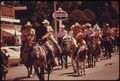 HORSE RIDERS PARADE DOWN THE MAIN STREET OF COTTONWOOD FALLS, KANSAS, NEAR EMPORIA, DURING FESTIVITIES FOR THE FLINT... - NARA - 557046.tif