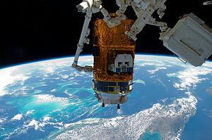 Kounotori 2 - Canadarm2 moves HTV-2 back to the nadir port of Harmony on 10 March 2011.