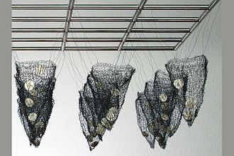 Roma Babuniak - Hanging Nets, Stainless steel, knitted wire, porcelain 100 x 100 x 38cm