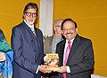 "Harsh Vardhan presented the book authored by him ""A Tale of Two Drops"" to the UNICEF Goodwill Ambassador, Mr. Amitabh Bachchan, at a function, in New Delhi on July 27, 2014.jpg"