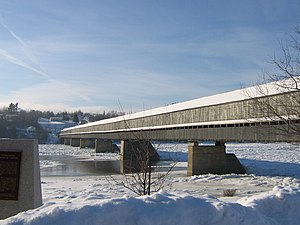 Hartland, New Brunswick - Longest covered bridge, showing pedestrian addition, with ice in the river