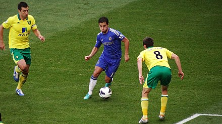 Eden Hazard in possession of the ball during a 2012 match between Chelsea and Norwich City Hazard taking on Howson.jpg