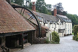 Bark mill - Overshot waterwheel at Combe House Hotel in Holford, Somerset, England.