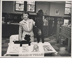 Hosmer Library - Children's Librarian Betty Welles demonstrating a display at the library.