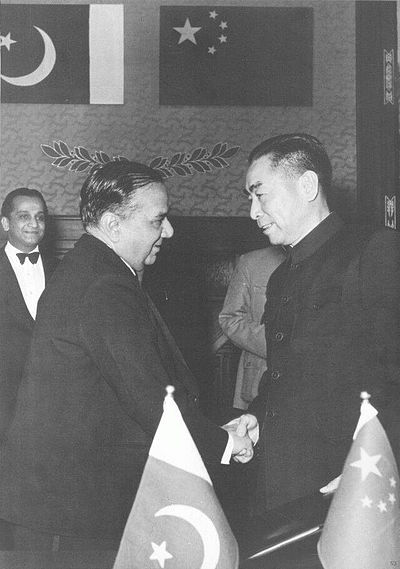 Pakistan Prime Minister Huseyn Shaheed Suhrawardy with Chinese Premier Zhou Enlai signing the Treaty of Friendship Between China and Pakistan. Pakistan is host to China's largest embassy. Huseyn Shaheed Suhrawardy and Zhou Enlai signing the Treaty of Friendship Between China and Pakistan in Beijing.jpg