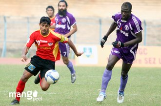 Sport in India - Sayed Rahim Nabi of East Bengal FC and Daniel of Chirag United SC during I league at Salt Lake Stadium.