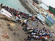 Indian evacuees from Yemen along with their belongings at jetty before embarking during Operation Raahat