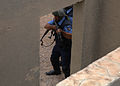 Iraqi police students stack on a door of a building while rehearsing room-clearing drills at the police academy in Basra, Iraq, April 20, 2011 110420-A-YD132-146.jpg