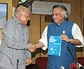 Jairam Ramesh being presented the report of the expert committee on the Draft Coastal Management Zone Notification by Dr. M.S. Swaminathan, in New Delhi on July 17, 2009.jpg
