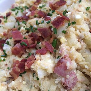 Japanese-style potato salad with Yukon gold potatoes, hard-boiled eggs, Kewpie, apple cider vinegar smoked sausage, bacon, fried shallots, and chives