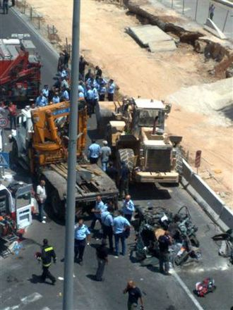 2008 in Israel - the loader used in the Jerusalem bulldozer attack on July 2, 2008 and a car which was destroyed during the attack