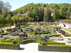Château du Grand Jardin - The restored parterre planted with exotic tropicals in silver and bronze, combines 16th-century and 19th-century garden styles