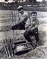 Jongens bezig met het steken van asperges - Boys harvesting asparagus (5897340040).jpg