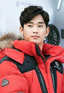 A photograph of Kim Soo-hyun looking at camera