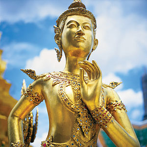 A gold statue of an Apsoni, a mythical half-woman, half-lion, on the Upper Terrace of Wat Phra Kaeo in the Grand Palace, Bangkok.