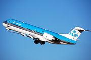 KLM Cityhopper Fokker F100 takes off