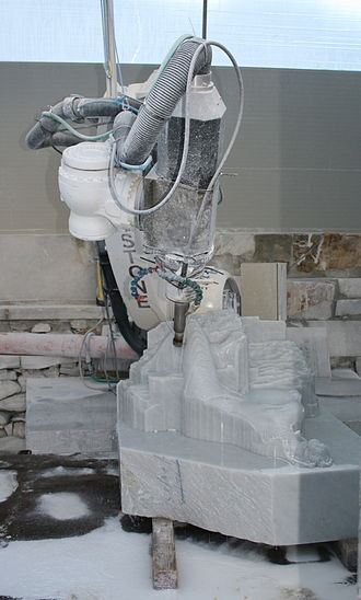 Pointing machine - A computer controlled router carving a sculpture from a block of marble