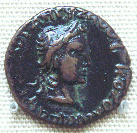 Coin of Kushan ruler Kujula Kadphises, in the style of Roman emperor Augustus. British Museum. AE dichalkon, Chach, c. first half of 1st. Century, Weight:3.26 gm., Diam:18 mm. Caption: obcerse in Greek KOZOLA KADAPhES XOPANOY ZAOOY; reverse in Kharoshti. KujulaKadphisesCoinAugustusImitation.jpg