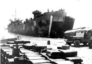 USS LST-31 - LST-31 off-loading over the beach at Okinawa, July 1945.