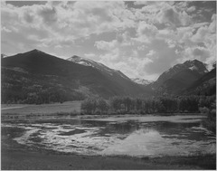 "Lake and trees in foreground, mountains and clouds in background, ""In Rocky Mountain National Park,""Colorado., 1933 - 19 - NARA - 519967.tif"