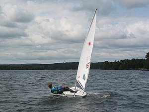 Laser (dinghy) - Sailor hiking out on a Laser Radial