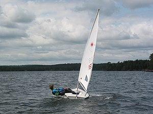Laser (dinghy) - Sailor hiking out on a Laser Radial