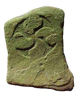 Lauburu - A lauburu carved into a stone.