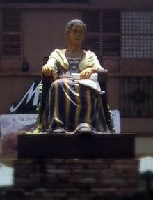 A statue of a sitting woman