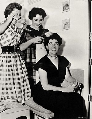 Helen Rose - From left to right: Annabella Levy, Elizabeth Taylor and Helen Rose on the set of Rhapsody (1954)