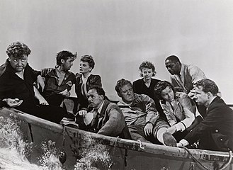 John Hodiak - L-R: Walter Slezak, John Hodiak, Tallulah Bankhead, Henry Hull, William Bendix, Heather Angel, Mary Anderson, Canada Lee, and Hume Cronyn in Alfred Hitchcock's Lifeboat (1944)
