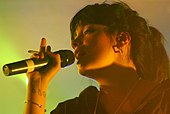 Close-up colour photograph of Lily Allen performing live in 2007.